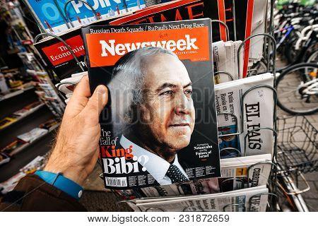 Paris, France - Mar 19, 2017: Man Reading Buying Newsweek Magazine Featuring Benjamin Netanyahu Aka