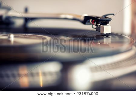 Low Angle View Of A Needle On A Retro Vinyl Gramophone Record Playing Music Indoors For Personal Ent