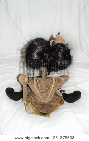 Creepy Steampunk Rag Doll Posed In A Sitting, Kneeling Position, Back View. Lifesize Doll On A Grung