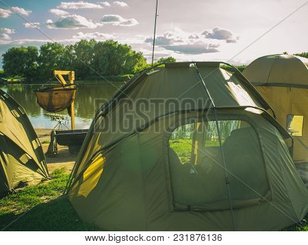Tent Camp On River Or Lake Beach, Summer Vacation. Shelter, Sunshade, Waterproof, Wind Proof. Camp,