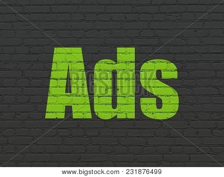 Advertising Concept: Painted Green Text Ads On Black Brick Wall Background