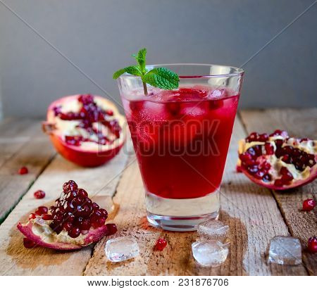 Pomegranate Cocktail With Ice Mint And Fruit On Wooden Table. Refreshing Summer Drink Soft Or Alcoho