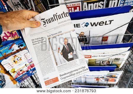 Paris, France - Mar 19, 2017: Man Reading Buying German Frankfurter Allgemeine Zeitung Newspaper At