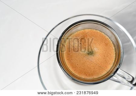 Espresso. Glass Espresso Cup With Coffee Beans On A Light Background
