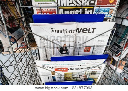 Paris, France - Mar 19, 2017: Man Reading Buying Newspaper At Press Kiosk Featuring Russian Presiden