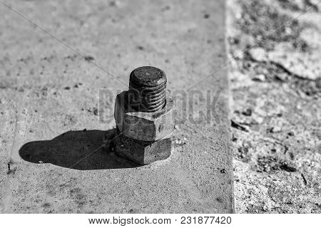 Rusty Screw Metal Nut Screwed With Corroded Bolts On Steel Beam On Grungy Background