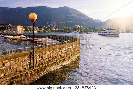 Lake Como And Pier With Boats At Sunset, Italy