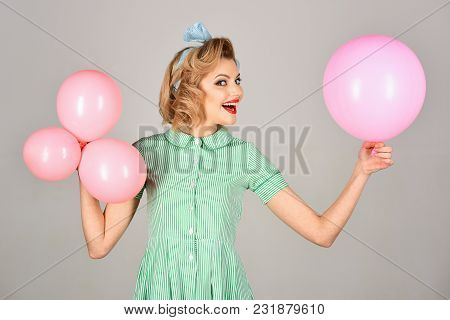 View Of Pinup Vintage Girl On A Grey Room With Balloons. Retro