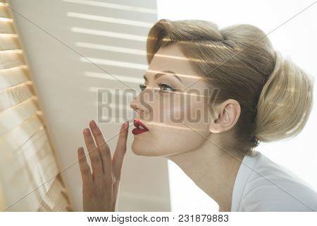 Girl With Strips Of Light And Shadows On Her Face. Woman With Interested Face With Makeup Going Spy