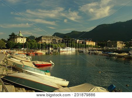 Pier With Boat In A Mountain Lake Como, Italy
