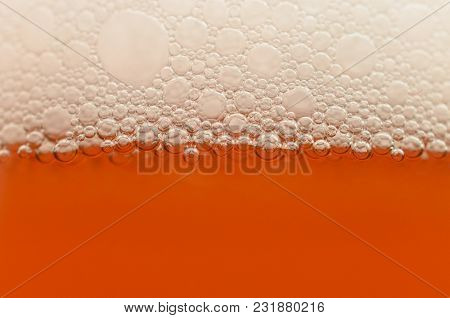 Bubbles From A Beer Froth Close-up On Half A Glass