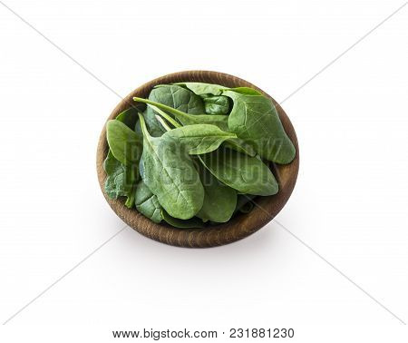 Spinach In Wooden Bowl. Top View. Spinach Isolated On A White Background. Green Spinach With Copy Sp