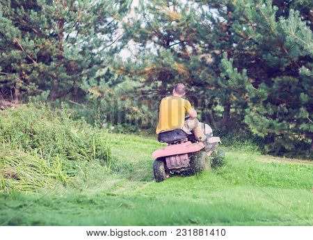Fresh Cut Grass Flying From Riding Lawnmower Person Cutting Long Green Grass With A Riding Lawn