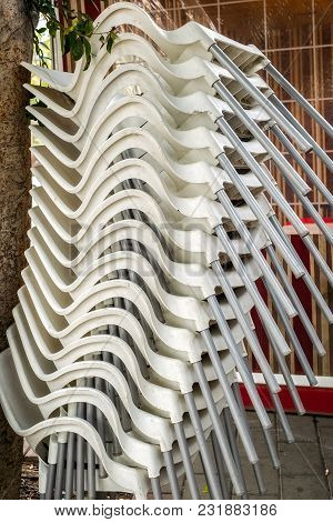 White Plastic Chairs Overlap In Vertical, Close View
