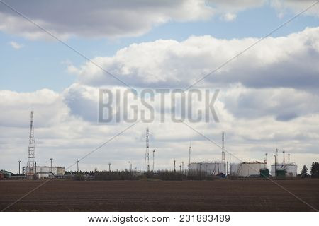 Oil Refinery With Oil Tanks On A Cloudy Summer Day. Landscape