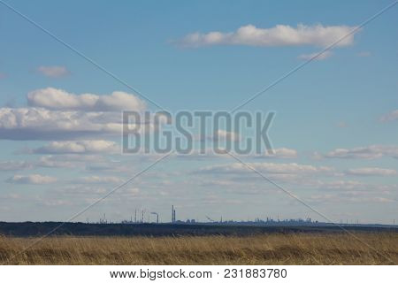 Landscape With Industrial Enterprise On The Horizon With Beautiful Cloudy Sky - Ecology Concept