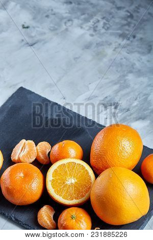 High Angle Still Life View Of Sliced Ruby Orange And Tangerine Arranged Together On The Right Side O
