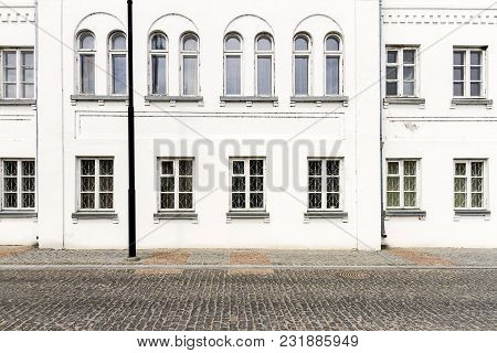 Luxurious Old Apartament House With A White Facade And Some Windows