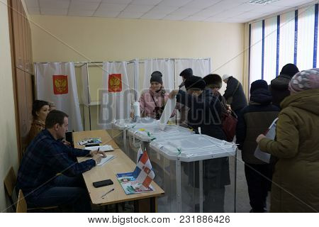 Berezniki, Russia-march 18, 2018: The Voter Receives The Ballot For The Election Of The President .