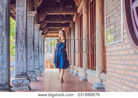Young Woman Tourist In Pagoda. Travel To Asia Concept. Traveling With A Baby Concept.