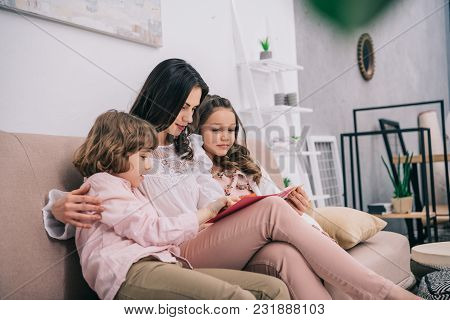Kids Showing Their Mother Greeting Card On Mothers Day