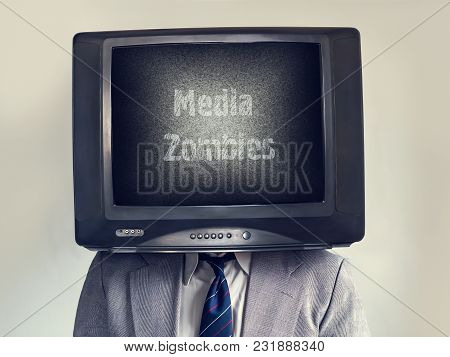 Man With A Tv Instead Of A Head. Media Zombie Inscription. The Multimedia Concept