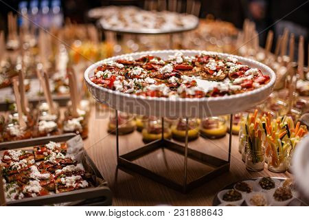 Big Table Full Of Appetizing Snacks On Plate And With Sticks.