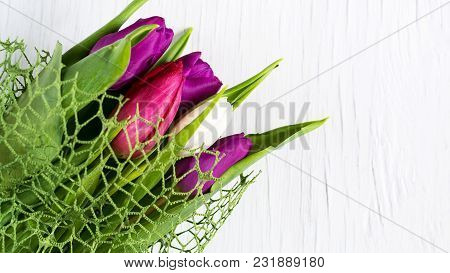 Beautiful Tulips Against White Wooden Background. Copy Space. Greeting Card