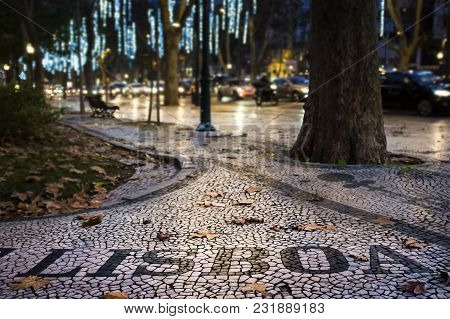 Detail Of The Beautiful Portuguese Pavement At The Liberdade Avenue In The City Of Lisbon, Portugal,