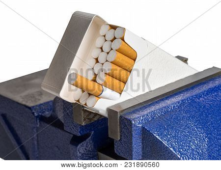 Pack Of Cigarettes Held In A Blue Vise Grip.  Isolated On White.  Concepts Could Include Smoking, Ad