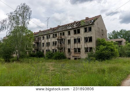 Facade Of A Abandoned Damaged Multistory Building