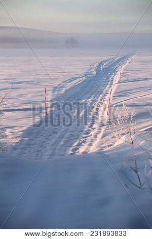 Road Over The Lake Menstraesket In Vaesterbotten, Sweden