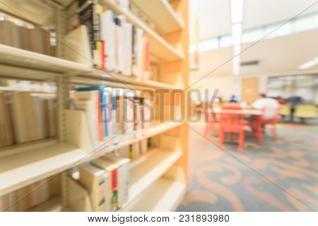 Blurred Library Bookshelf With Reading Area In American Public Library