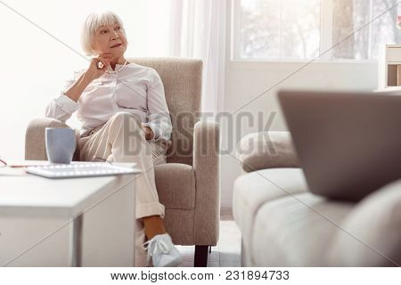 Waiting For Guests. Charming Elderly Woman Waiting For Someone To Come In, Looking At The Doors Of T
