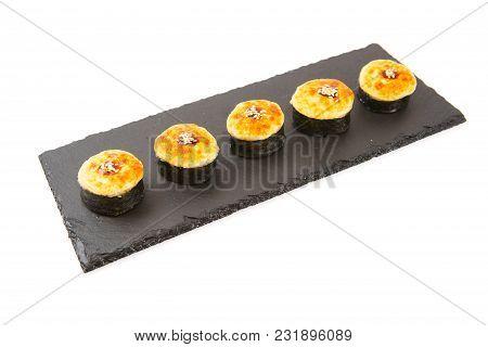 Fried Sushi Salmon Sushimi On A Black Surface On White.