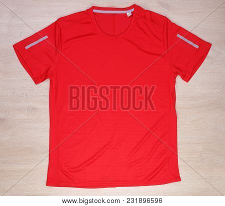 Red Running T-shirt On Wooden Background, Red Sport Shirt