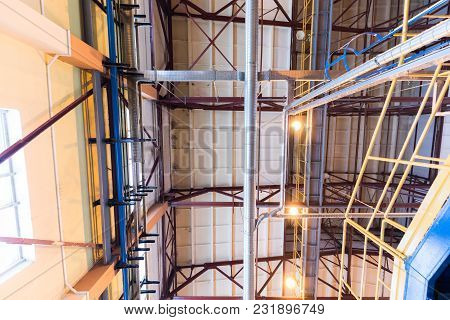 Down Up View Of Modern Operational Plant With Grey Pipes And Ladders Heavy Industry Machinery Metalw