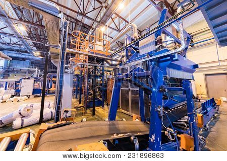 Modern Operational Plant Equipment Producing Fiberglass With Rolls Of Rock Wool Or Glass Wool On The