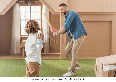 Handsome Father Teaching His Son How To Play Baseball