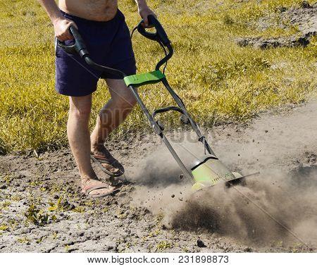 Garden Manipulator For Work. Plowing The Site. Garden. The Front Garden. Lawn. Fertilizer And Land R