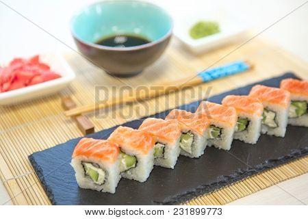 Sushi Rolls On Black Slate Surface. Japanese Food.