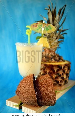 Milk Fruit Cocktail In An Irish Mug Decorated With A Piece Of Pineapple, An Umbrella And A Straw On