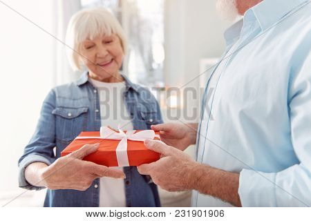 Best Gift. The Focus Being On The Hands Of A Well-build Handsome Man Receiving A Gift From His Belov