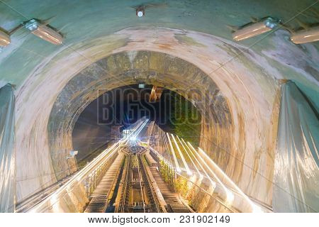 Funicular Ride, Rails And Tunnel En Route Within Tunnel With Lights And Zoom Blur  Light Trails From