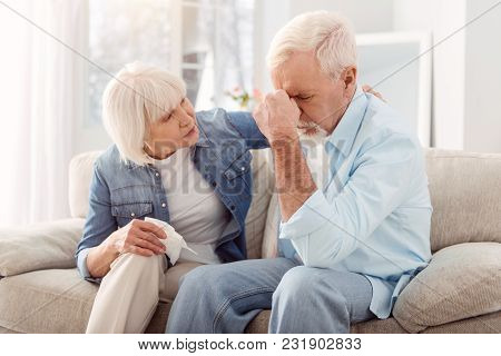 Keep Calm. Caring Elderly Woman Stroking Her Husbands Back And Consoling Him While He Crying, Being
