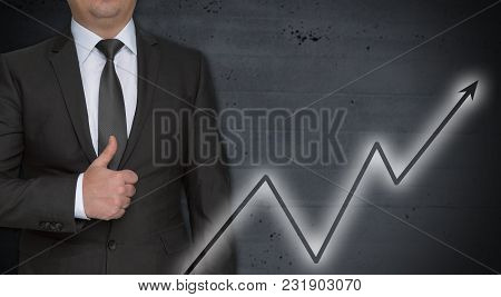 Graph Concept And Businessman With Thumbs Up.
