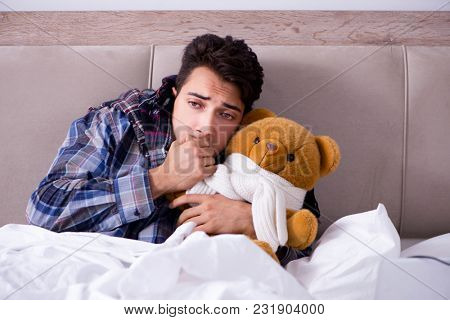 Sick man suffering from flu in the bed