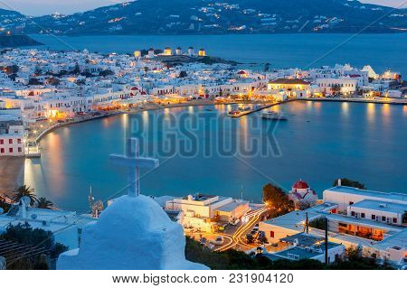Aerial View Of The City Chora From A Hill On The Sunset. Greece. The Island Mykonos.