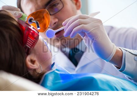 Patient visiting dentist for regular check-up and filling