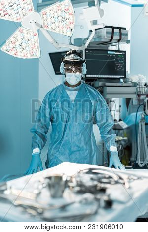 African American Surgeon Looking At Camera In Operating Room